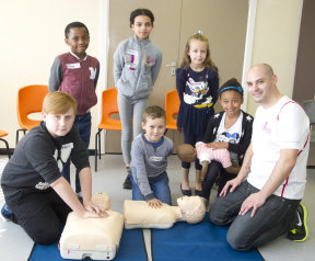 Children in Swinton learn how to save lives with Dan Thompson from the Millie's Trust charity.