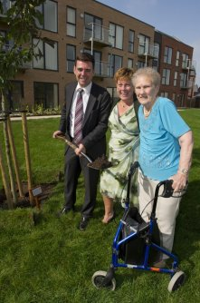 Andy Burnham MP (right) plants a tree to mark the opening of Amblecote Gardens with City West's Deputy Chief Executive Colette McKune (centre) and Dorothy Worthington (right), one of the facility's first residents.