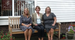 Hanover Housing Association Chief Executive Dame Clare Tickell with the 50+ Award and Housing Managers (Left) Tracy Williams and Tracy Bowmer+ Awards